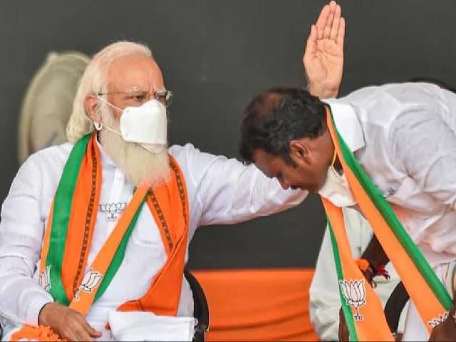 PM Modi and L Murugan